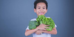Child holding vegetables