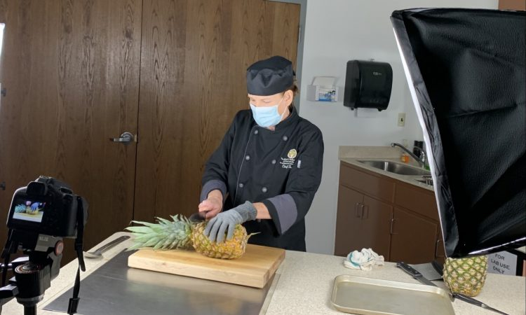 Chef Tracey cutting a pineapple